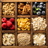 Breakfast foods in a wooden box overhead shot Royalty Free Stock Images