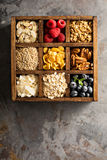 Breakfast foods in a wooden box overhead shot Royalty Free Stock Photography