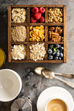 Breakfast foods in a wooden box overhead shot Royalty Free Stock Photos