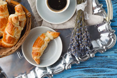 Breakfast with french croissant and bunch of lavender Royalty Free Stock Images