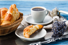 Breakfast with french croissant and bunch of lavender Stock Photos