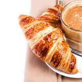 Breakfast with French Croissants and Coffee on a white plate and Royalty Free Stock Image