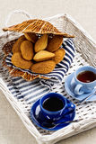 Breakfast. French pastries madeleines with cup of coffee. Selective focus Stock Photos