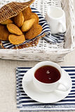 Breakfast. French pastries madeleines with cup of tea. Selective focus Royalty Free Stock Photo