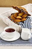 Breakfast. French pastries madeleines with cup of tea. Selective focus Royalty Free Stock Photos