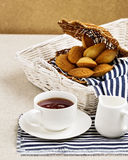 Breakfast. French pastries madeleines with cup of tea. Selective focus Stock Image