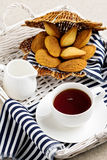 Breakfast. French pastries madeleines with cup of tea. Selective focus Royalty Free Stock Images