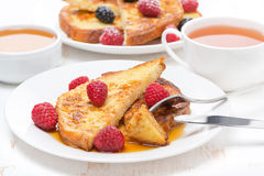 Breakfast - french toast with raspberries, honey Royalty Free Stock Photos