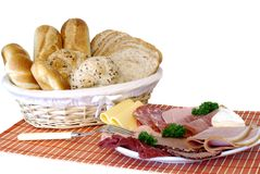 Breakfast, fresh baked  bread, cheese and meat Stock Images
