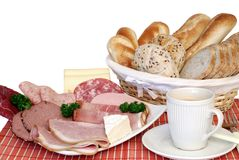 Breakfast, fresh baked  bread, cheese and meat Royalty Free Stock Photos