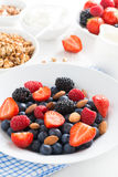 Breakfast with fresh berries, vertical, close-up. Top view Stock Image