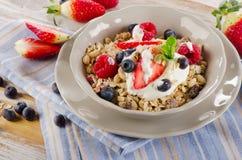 Breakfast with fresh berries, yogurt and  muesli. Stock Photography
