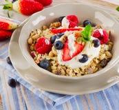 Breakfast with fresh berries, yogurt and  muesli. Royalty Free Stock Photo