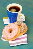 Breakfast with fresh black coffee and donuts Royalty Free Stock Photo
