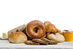 Breakfast with fresh bread, buns bagel royalty free stock image