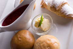Breakfast with fresh buns and croissant and raspberry jam Royalty Free Stock Photos