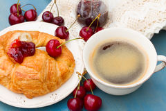 Breakfast with fresh croissants and cherries Royalty Free Stock Photo