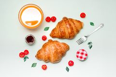 Breakfast with fresh croissants and orange juice, top view.  stock image