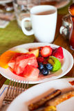 Breakfast with fresh fruits and coffee Royalty Free Stock Images