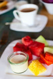 Breakfast with fresh fruits and yoghurt Stock Photos