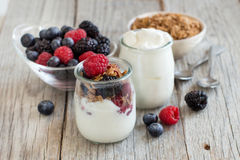 Breakfast with Fresh greek yogurt, muesli and berries Royalty Free Stock Photos