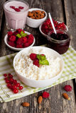 Breakfast with fresh homemade cottage cheese with raspberry Stock Photo