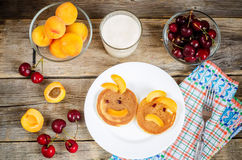 Breakfast with fresh pancakes with cherries and apricots for kid Royalty Free Stock Photography