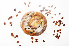 Breakfast. Fresh sweet bun with powdered sugar and raisins on wh Royalty Free Stock Photo