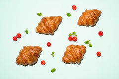 Breakfast with fresh tasty croissants on green background Royalty Free Stock Photos