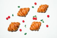 Breakfast with fresh tasty croissants on green background Stock Photography