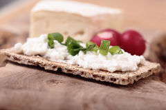 Breakfast with fresh vegetables. Breakfast with cottage and blue cheese on the cutting board Royalty Free Stock Image