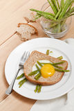 Breakfast with fried egg and asparagus Royalty Free Stock Photography