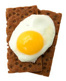Breakfast: fried egg and crisp bread Royalty Free Stock Images