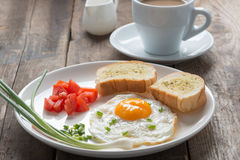 Breakfast fried egg with garlic bread. Stock Image