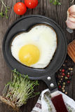 Breakfast with fried egg in heart-shaped form Stock Photography