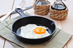 Breakfast the fried egg in a iron frying pan Royalty Free Stock Images