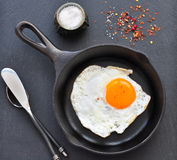 Breakfast the fried egg in a iron frying pan Stock Images