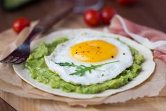 Breakfast with fried egg and sauce of avocado on grilled flour Royalty Free Stock Image