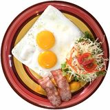 Breakfast. Fried egg with sausage, bacon and salad Royalty Free Stock Photo