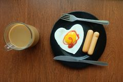 Breakfast, Fried egg with sausage and Coffee By the window balcony in the cold. Winter or raining. Topview stock image