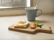 Breakfast ,Fried egg on the toast and cup of coffee Stock Photography