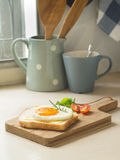 Breakfast ,Fried egg on the toast and cup of coffee Stock Images