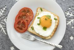Breakfast with fried egg on toast. royalty free stock photography