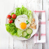 Breakfast with fried egg Stock Photos