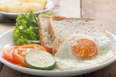 Breakfast fried egg with whole wheat breads. Stock Photos