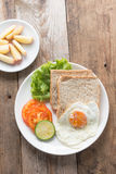 Breakfast fried egg with whole wheat breads. Royalty Free Stock Image