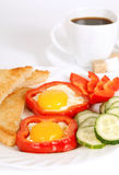 Breakfast with fried eggs. Pepper and toasts stock photos