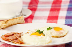 Breakfast. Fried eggs with bacon Stock Images