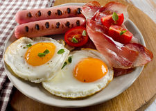 Breakfast with fried eggs,bacon, toasts Stock Image