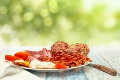 Breakfast with fried eggs, bacon, tomato and buns, Chrono diet c. Breakfast with fried eggs, bacon, tomato and buns on a plate, Chrono diet concept Stock Photo